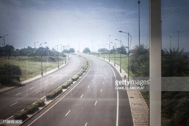 A person drives a car on the highway leading Malabo to Sipopo in Sipopo nearly 16km from Malabo in Equatorial Guinea on April 20 2019 In Sipopo a...