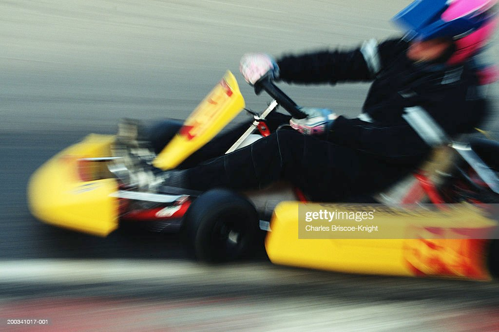 Person driving go-cart, side view (blurred motion) : Bildbanksbilder