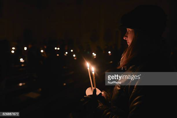 A person during the Easter Vigil Mass at the Catholic Church dedicated to Mary Immaculate Refuge of Sinners in Rathmines Easter Vigil also known as...