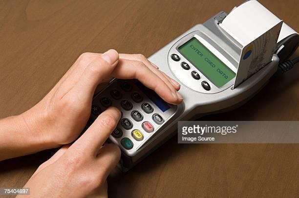 Person entering pin into card reader