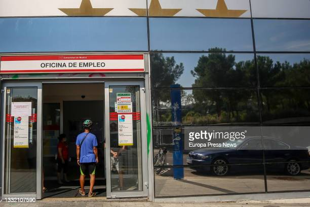 Person enters a SEPE office in Puerta del Angel, on the day the data on registered unemployment and Social Security affiliation for the month of July...