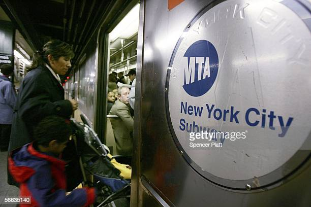 A person enters a subway car January 20 2006 in New York City New York's transit workers narrowly rejected a proposed contract January 20 that was...