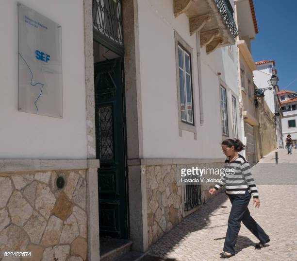 A person enters Portugal's SEF Regional Delegation on July 25 2017 in Cascais Portugal According to the SEF the number of citizens from other...