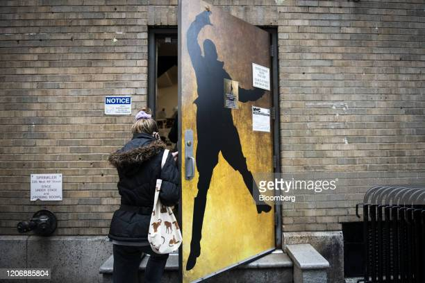 Person enters the staff and performers entrance of Richard Rodgers Theatre where the musical Hamilton is performed in the Times Square neighborhood...