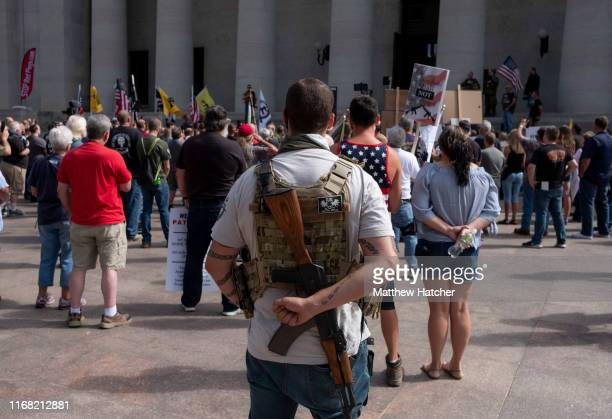 A person exercises their right to open carry a firearm as gun owners and second amendment advocates gather at the Ohio State House to protest gun...