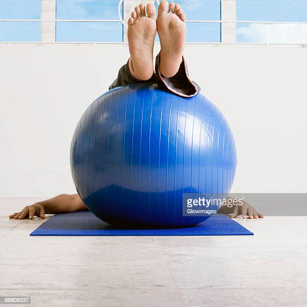 person exercising with a fitness ball - female feet soles stock photos and pictures