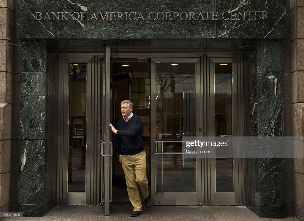 A person exits the Bank of America headquarters on February 4, 2010 in Charlotte, North Carolina. Bank of America's former Chief Executive Officer Ken Lewis and former Chief Financial Officer Joe Price have been charged with securities fraud by the New York attorney general.