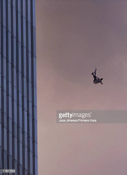 A person falls to his death from the World Trade Center after two planes hit the Twin Towers September 11 2001 in New York City