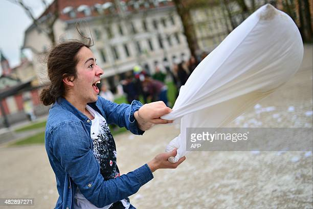 A person fights with a pillow during an International Pillow Fight Day in Ljubljana Slovenia on April 5 2014 AFP PHOTO / Jure Makovec