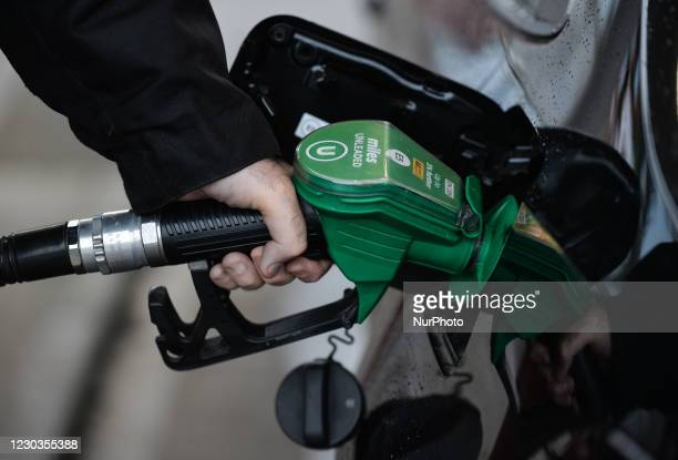 Person filling up a petrol tank in petrol station near Jonesborough. On Tuesday, December 29 in Jonesborough, County Armagh, Northern Ireland, United...