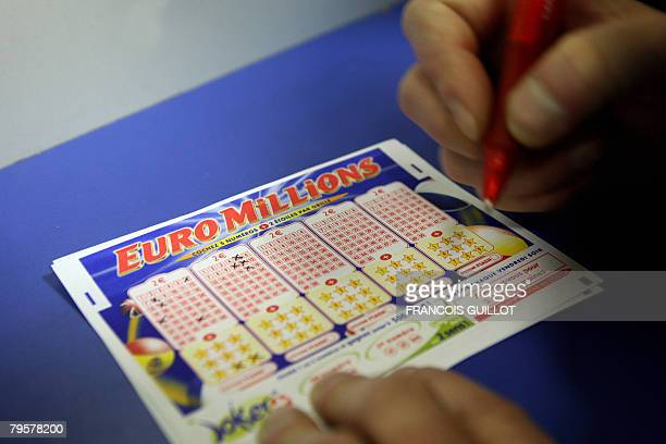 A person fills an Euro Millions lottery ticket on February 6 2008 in Paris Gamblers across Europe are to go neckandneck for a chance to win the 130...