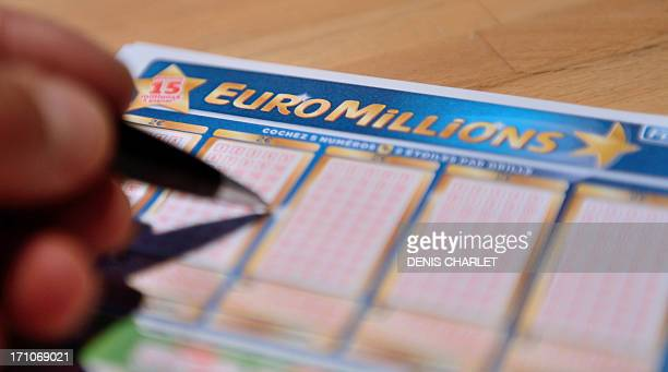 A person fills an Euro Millions lottery ticket on June 21 2013 in Lille northern France No player discovered the seven correct numbers needed to win...