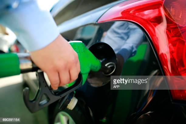 A person fills his tank at a gas station on May 31 2017 in Paris as truck drivers transporting dangerous materials are continuing their strike...