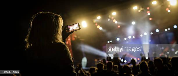 Person filming a concert