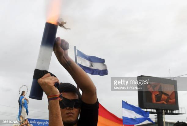 A person fires a homemade mortar as he joins thousands of Nicaraguan antigovernment protesters including members of the Lesbian Gay Bisexual...