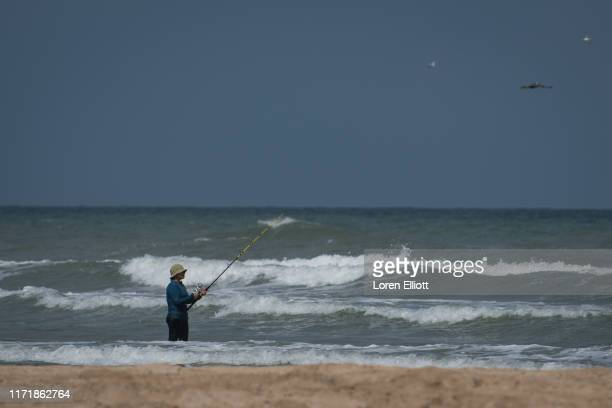 Person fishes in the surf near SpaceX's launch facility on September 28, 2019 in Boca Chica near Brownsville, Texas. SpaceX CEO Elon Musk is using...