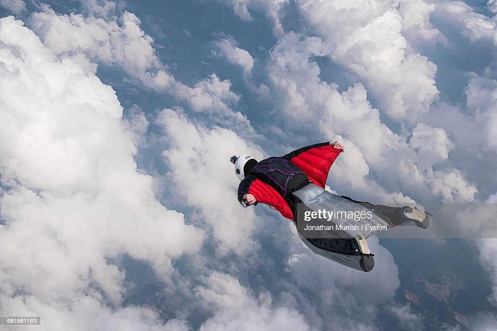 Person Flying Above Clouds In Wingsuit : Stock Photo