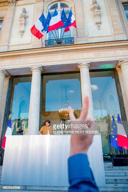 A person gestures as French DJ and producer Chloé Thévenin aka DJ Chloe performs during the annual 'Fete de la Musique' in the courtyard of the...