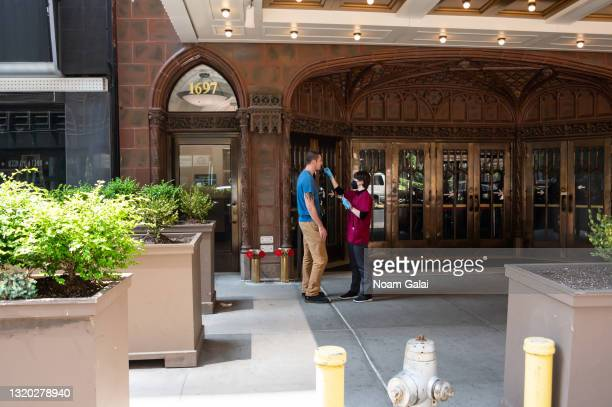 """Person gets a COVID-19 test outside The Late Show with Stephen Colbert at the Ed Sullivan Theater on May 26, 2021 in New York City. """"The Late Show..."""