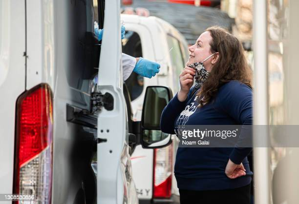 Person gets a PCR test outside a HealthSync COVID-19 testing van on March 22, 2021 in New York City. After undergoing various shutdown orders for the...