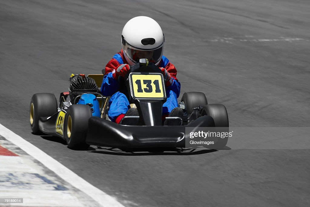 Person go-carting on a motor racing track : Stock Photo