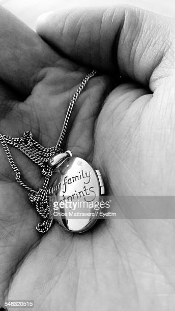 person hand holding locket - chloe amour stock pictures, royalty-free photos & images