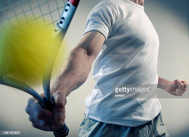 person hitting yellow ball with tennis racquet