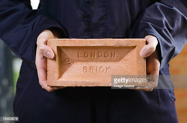 Person holding a brick