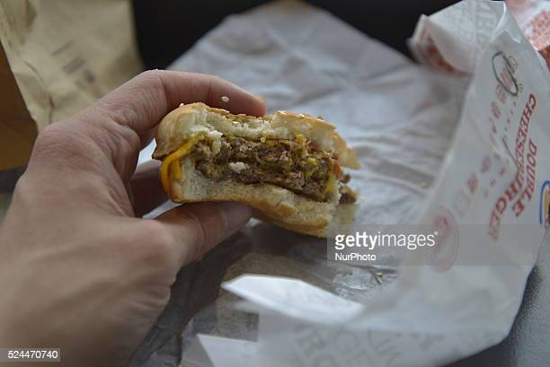 A person holding a Burger King burger on Wednesday 16th September 2015