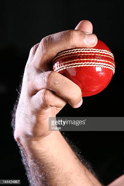 Person holding a Cricket ball