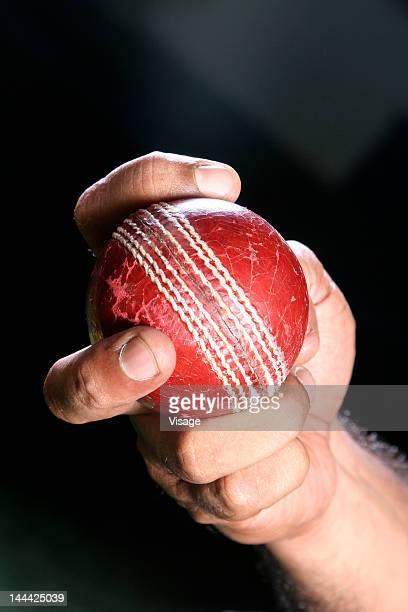 Person holding a Cricket ball