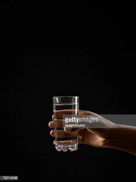 Person holding a glass of water