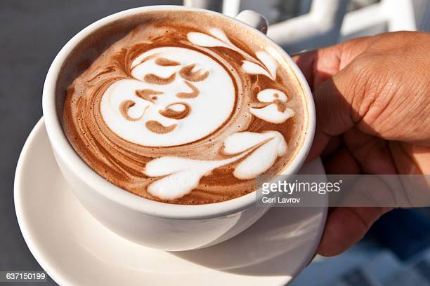 person holding a latte coffee drink - coffee drink stock pictures, royalty-free photos & images