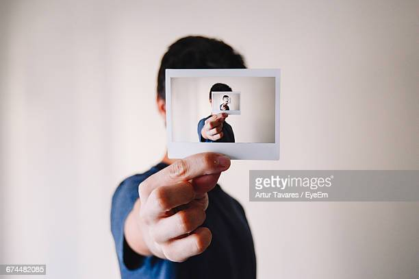 person holding a photograph of himself - repetition stock pictures, royalty-free photos & images