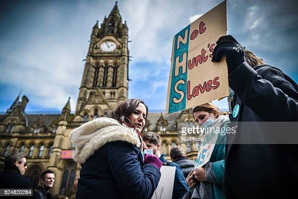 A person holding a placard in Albert Square in front of Manchester Town Hall in Manchester Greater Manchester England United Kingdom on Tuesday 26th...
