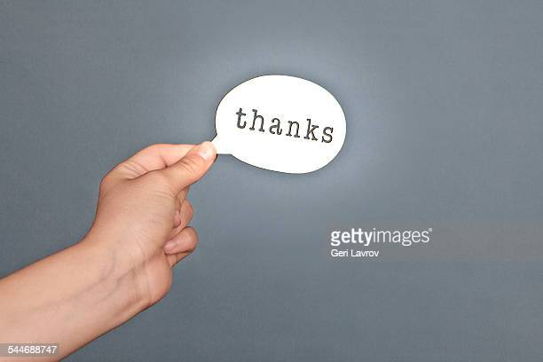 person holding a 'thanks' message sign - thanks quotes stock pictures, royalty-free photos & images
