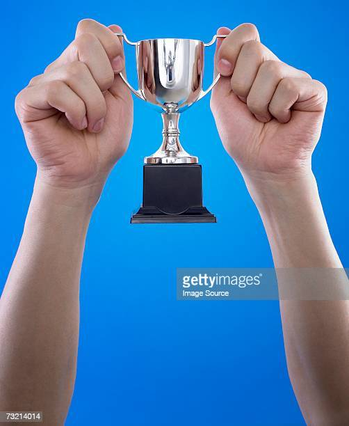 person holding a trophy - holding trophy stock pictures, royalty-free photos & images