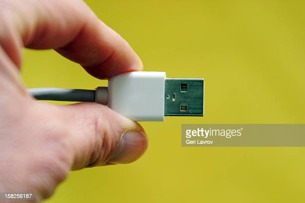Person holding a USB cable