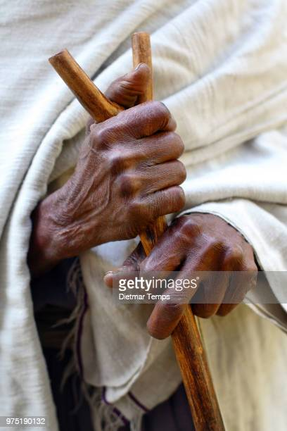 A person holding a walking stick in Lake Tana, Ethiopia.