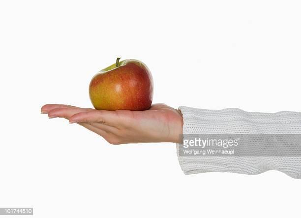 person holding an apple - 袖 ストックフォトと画像