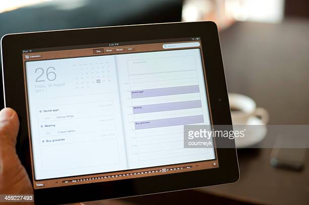 person holding an ipad - apple event stock photos and pictures
