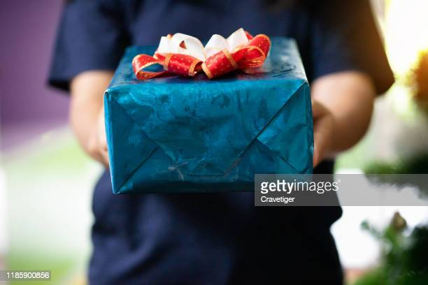 person holding and delivery christmas gift . - receiving stock pictures, royalty-free photos & images