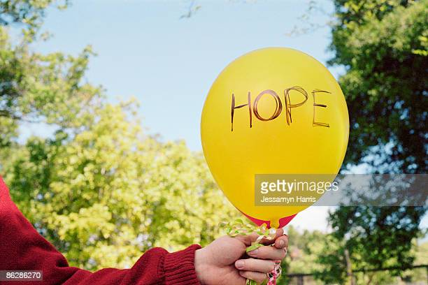 Person holding balloon
