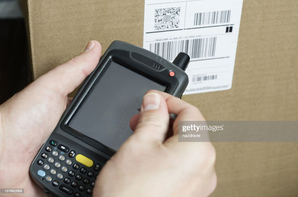 Person Holding Barcode Scanner Taking Inventory Stock Photo - Getty