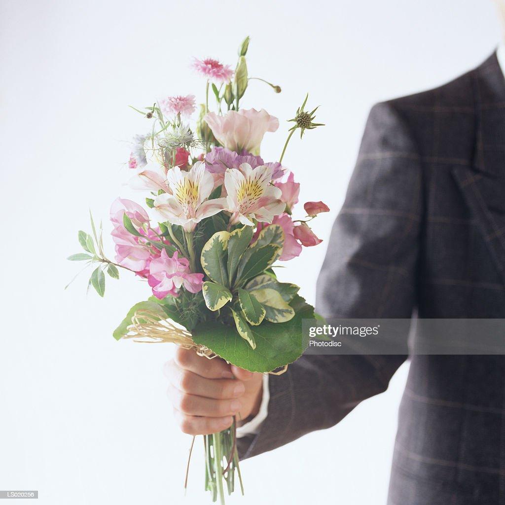 Person holding bouquet of flowers stock photo getty images person holding bouquet of flowers stock photo izmirmasajfo