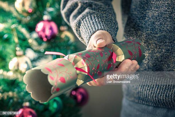 person holding christmas cracker - クリスマスクラッカー ストックフォトと画像