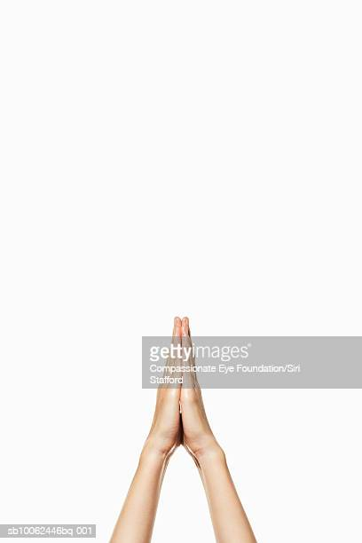 "person holding clasped hands up in air, close-up - ""compassionate eye"" fotografías e imágenes de stock"