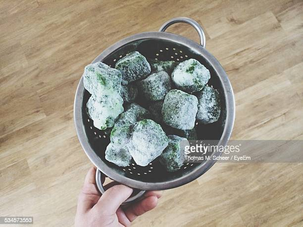 Person Holding Colander With Frozen Vegetables