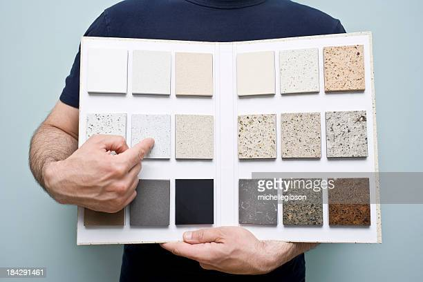 Person holding countertop sample folder
