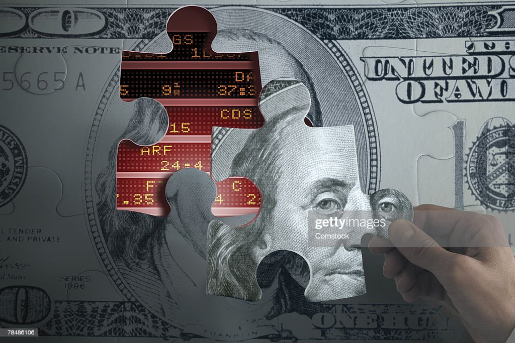 Person Holding Currency Jigsaw Puzzle Piece Over Stock